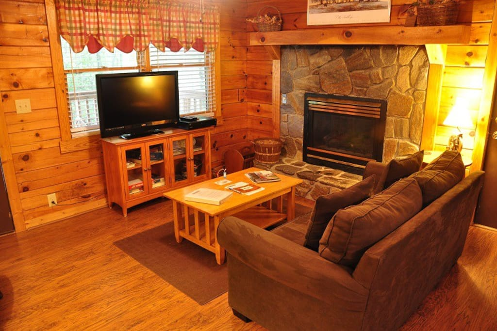 Living Room with Gas Fireplace, Satellite TV, and Board Games
