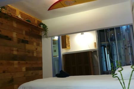 This very cozy studio will blow your mind: not even a minutes walk from the surf beach of San Sebastian. Everything inside is made by ourselves, except for the super deluxe shower and the comfortable bed. Come here to have a relaxed holiday in style!