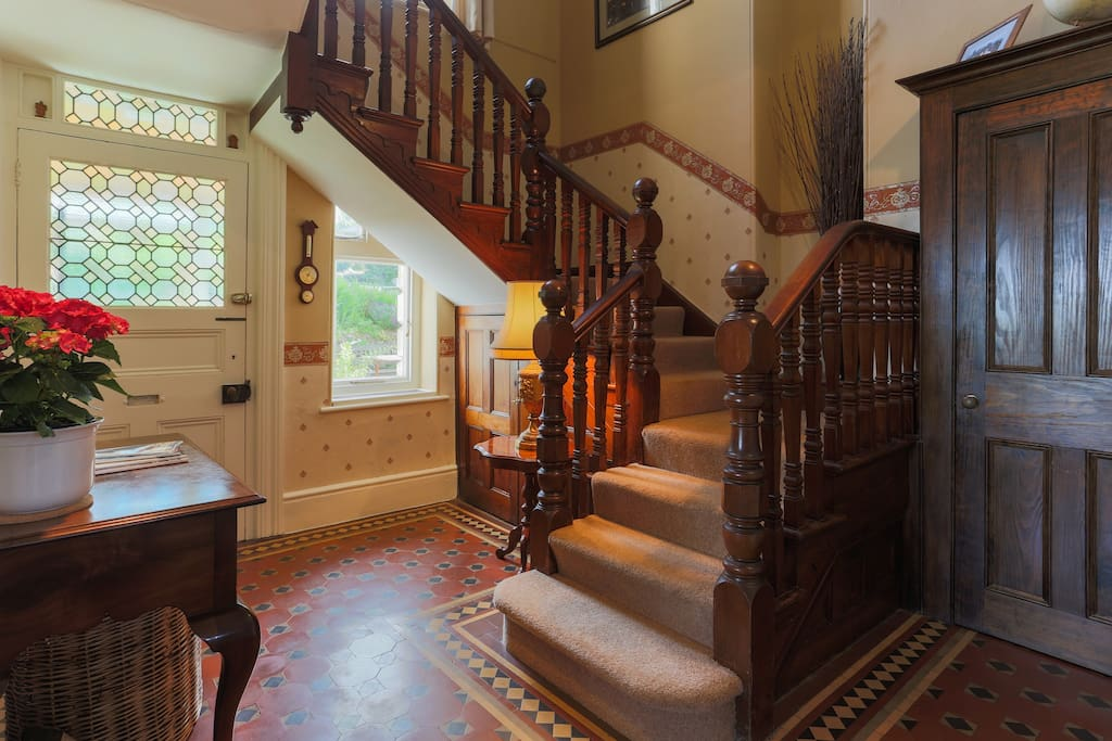 Beautiful original staircase and floor tiles