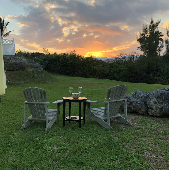 Perfect evenings relaxing with a lovely sunset. View out the front door to the lawn looking over North Shore and the Beautiful ocean surrounding Bermuda.
