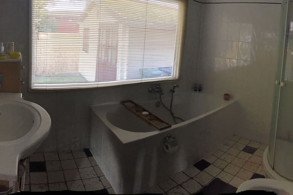 Bathroom with nice big bath and seperate shower