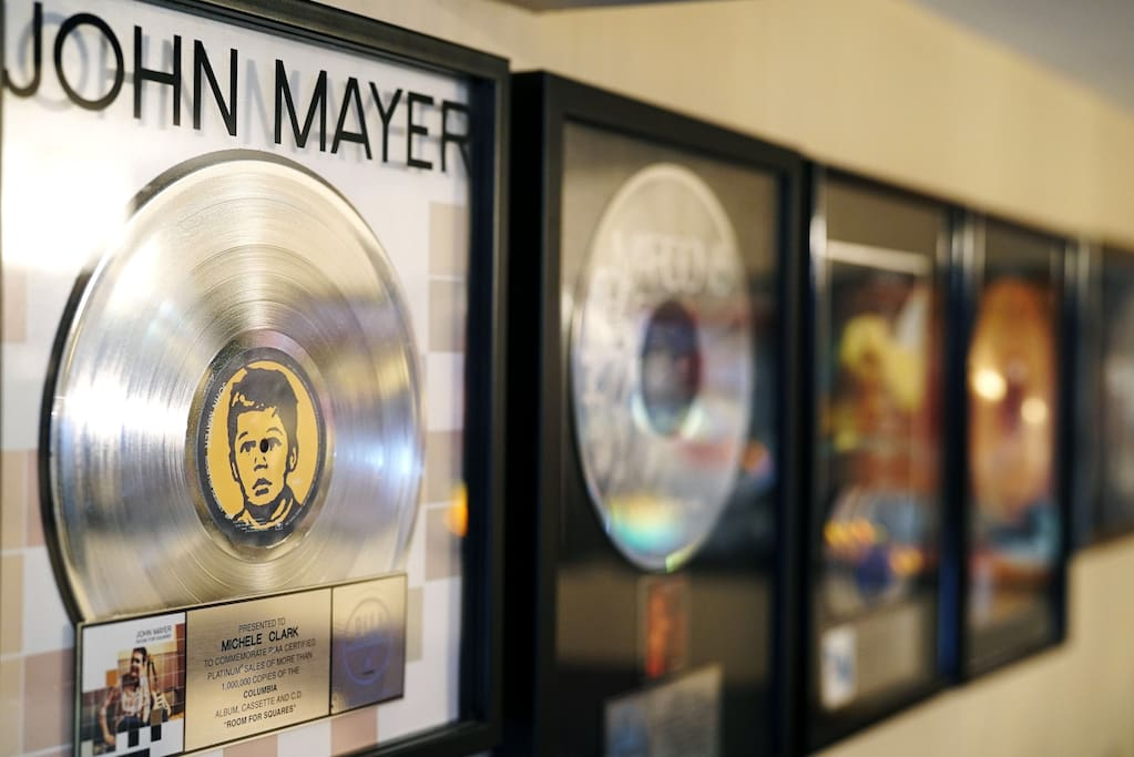 Walls are decorated with awards and platinum records presented to the owner for the artists she helped get played on the radio !