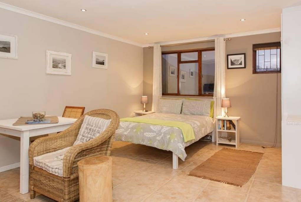 Double bed with beautiful sea-view from bedroom window