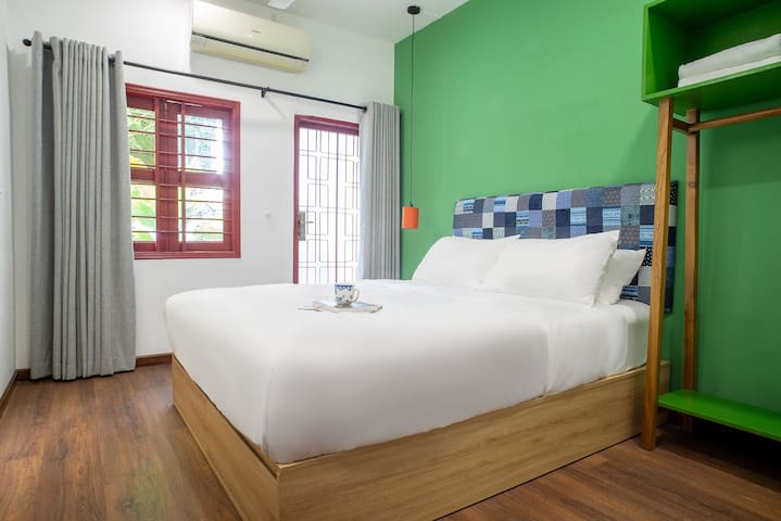 Our second bedroom features a private balcony and hotel-quality bed