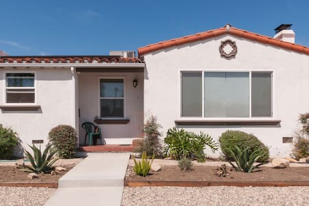 Queen bed, private bathroom.  Can accommodate 2 people.  Free wifi, ramp, common areas.  Wired internet.  Parking is available with a pass.  Laundry on scene, solar is installed.  Kitchen new.  Living room, front porch and backyard with bbq common.