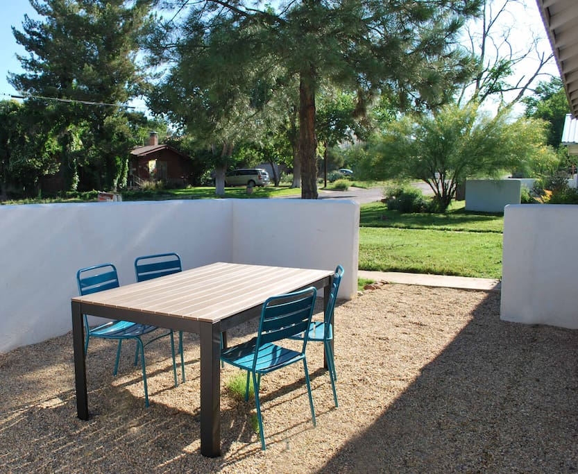 A view of the patio with dining table and chairs.