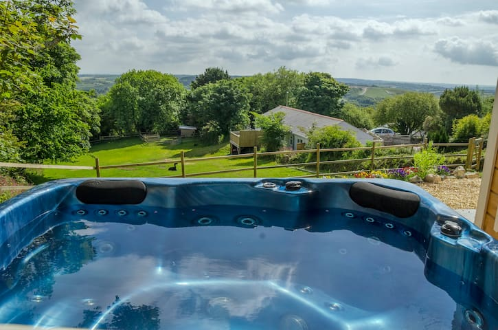 The hot tub with fabulous views over the alpaca paddock and the Cornish countryside.