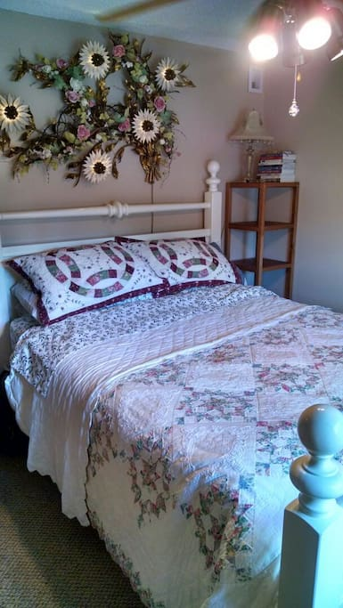 Floral quilts and Queen Bed