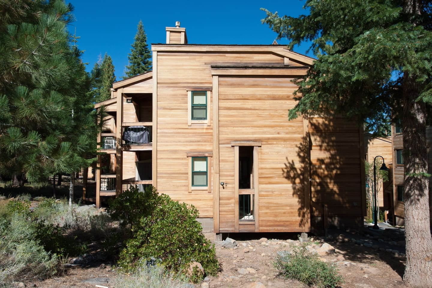 The condo has a nice modern, yet rustic feeling, nestled in the pine tree-filled hills just a short walk or free shuttle ride to the Northstar village.