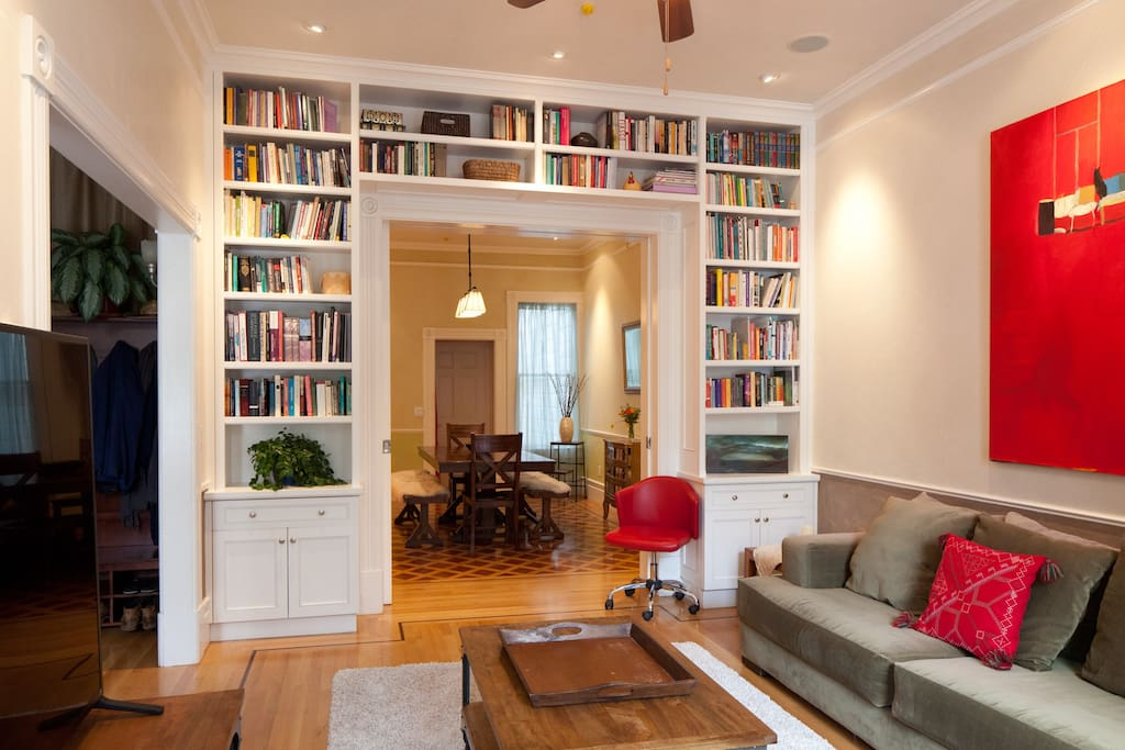 Wall to wall bookshelves and large comfortable couch | SF Victorian Dream House