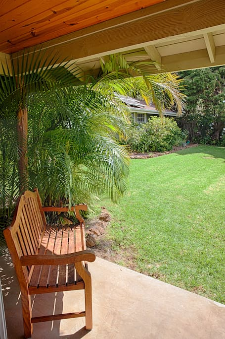 Or relax on the covered lanai with a garden view