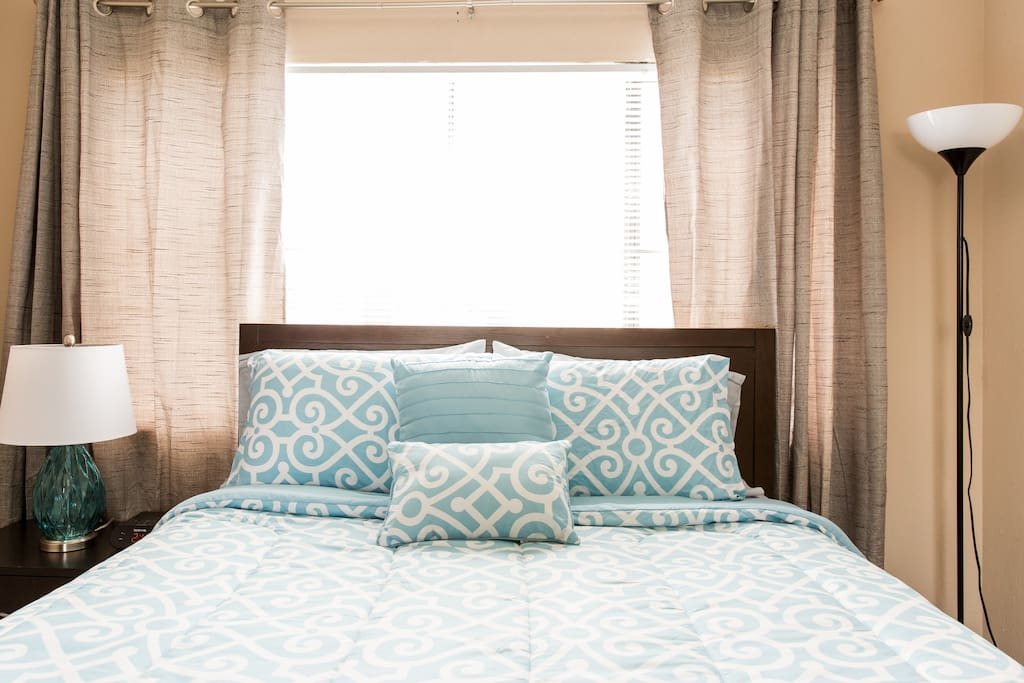 Queen Bed for two people, alarm clock with iPod dock, reading lamp, plenty of closet space in mirrored closet.