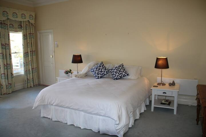 Master bedroom with King-size bed and ensuite bathroom
