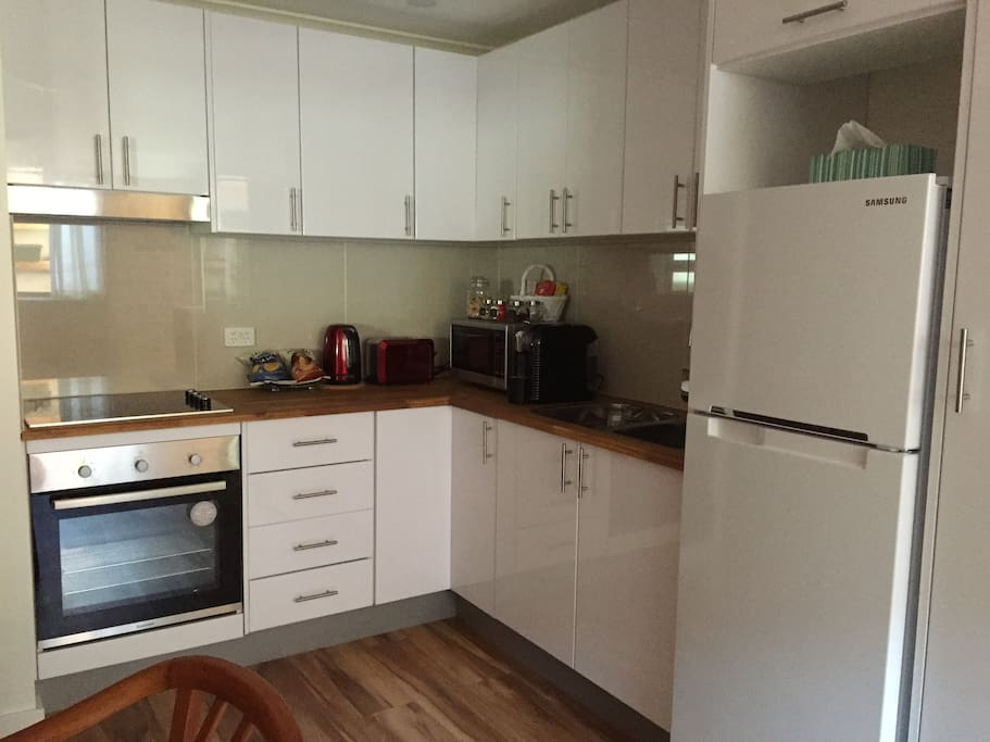 Full kitchen with all cook top/oven and microwave.