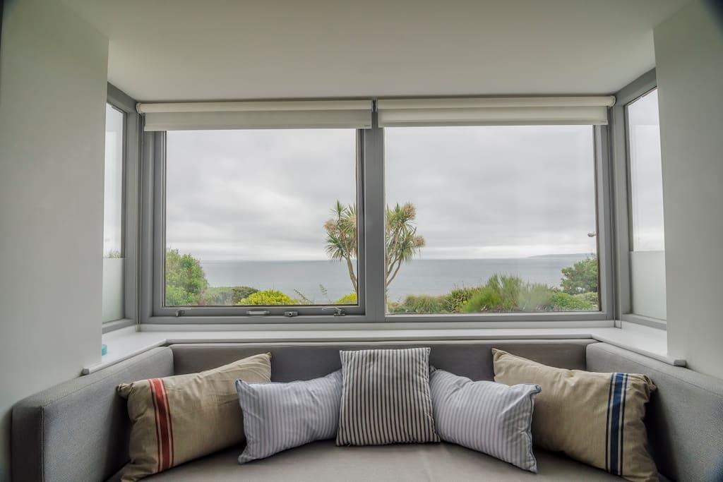 Panoramic views of Falmouth Bay. Enjoy the window seat. Binoculars available