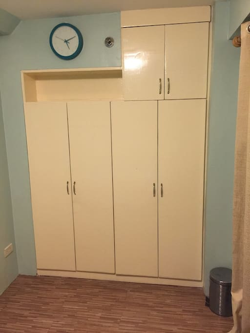 cabinet opposite the bed