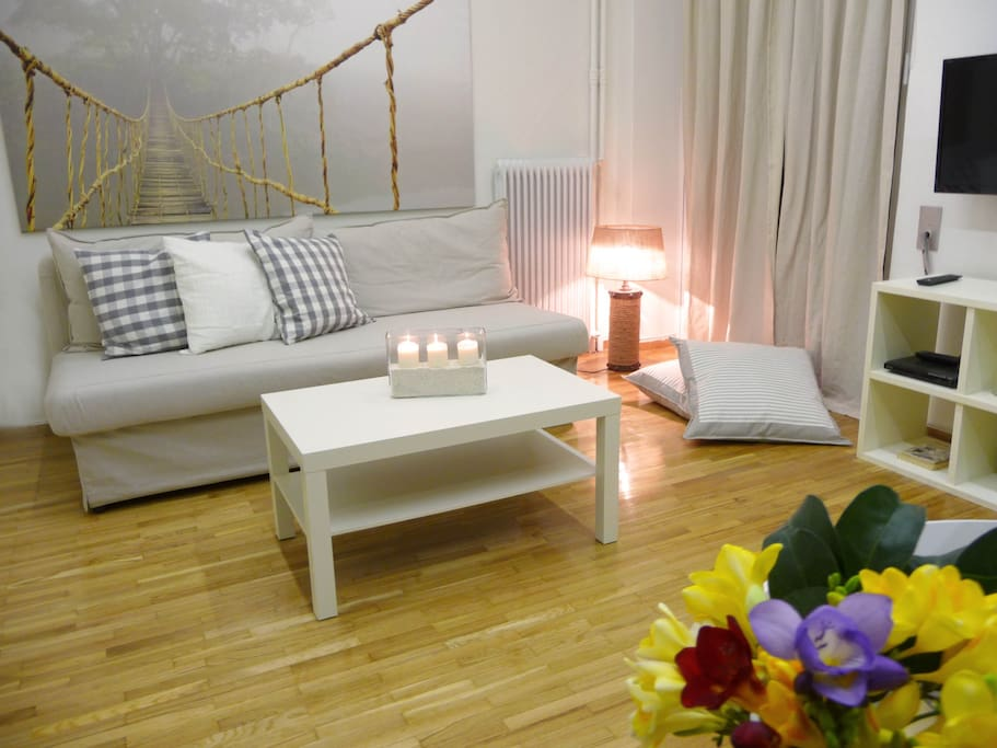 The open-plan living area is first off the entrance hall – a white-painted room full of clean-cut furniture and cool shades