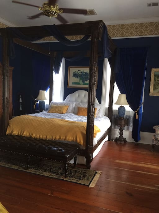 Magnificent hand carved king sized canopy bed. Our guests love the down comforter and soft pillows and linens.