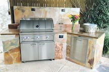 Stunning outdoor kitchen Lynx Grill set in copper top and Mediterranean stone