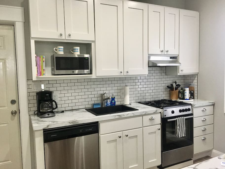 Brand new kitchen with dishwasher, oven/stove, microwave, coffee pot. All cookware/dining ware included.