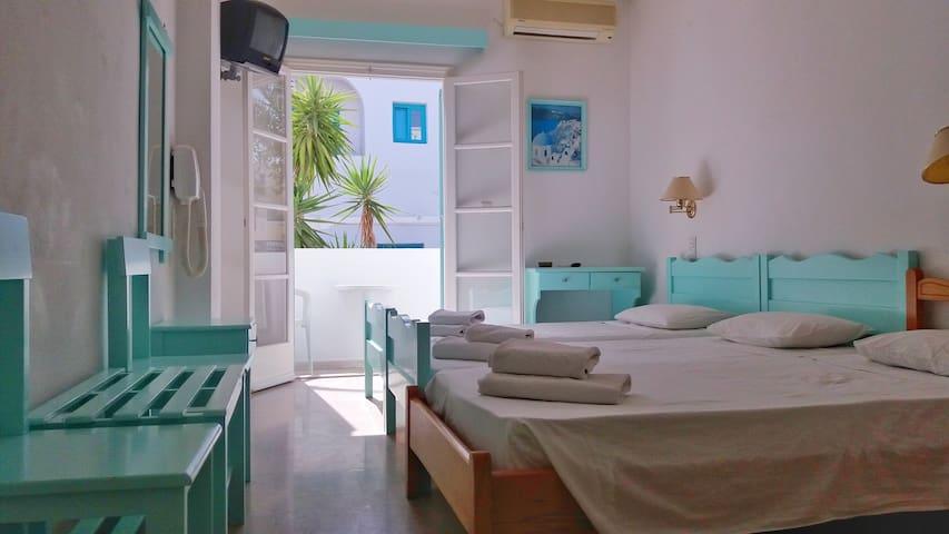 Kymata Hotel C - Cozy B&B Triple Room in Kamari.