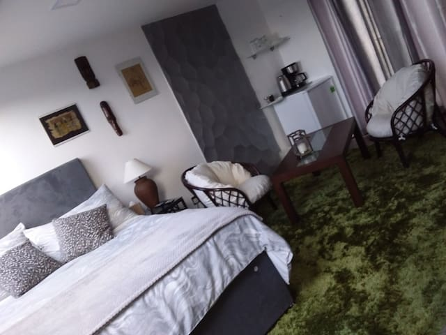 conterporary double bedroom with en-suite, tv
