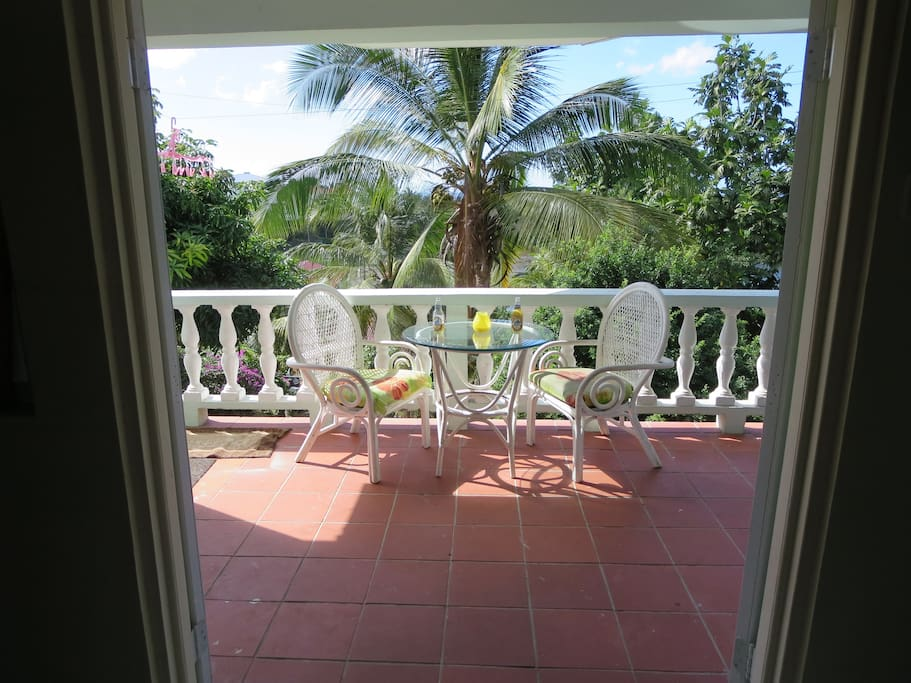 Suite features a large balcony with a beautiful garden view.