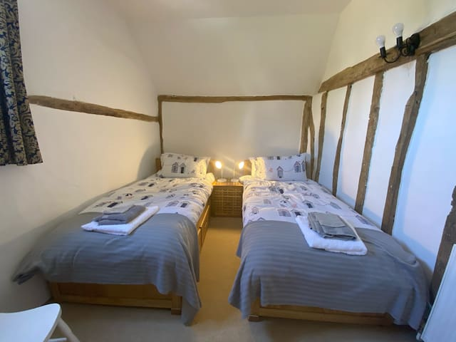bedroom 3, with original features and 2 no. single beds.