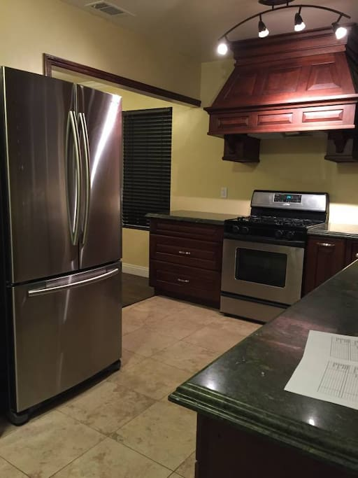Chef's kitchen with stainless steel appliances including dishwasher
