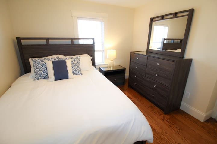 Queen bed with closet and dresser space!