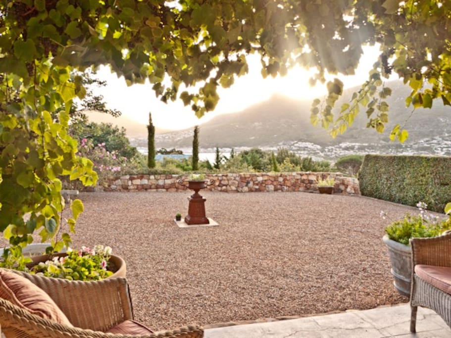 The gravel courtyard with views of the bay