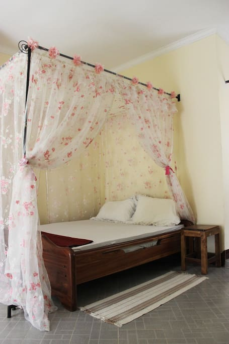 Mosquito nets and curtains for comfortable sleep. We can change curtains if you don't like flowers :)