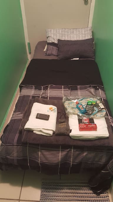 twin bed with 4in memory foam mattress for your comfort, some small amenities for guest stay.