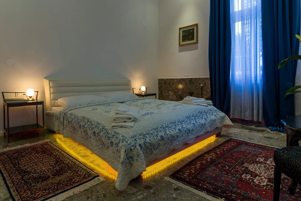 Your very own Royal bedroom with a king size bed with 4 independent lighting systems to create a perfect ambient, all adjustable from the bed.(210x180)  E&E Apartments Ljubljana center.