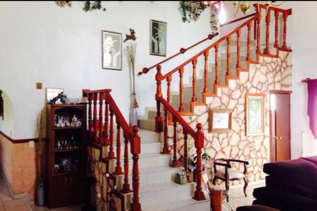 Living room and the stairs that leads to your room, right after entering the house