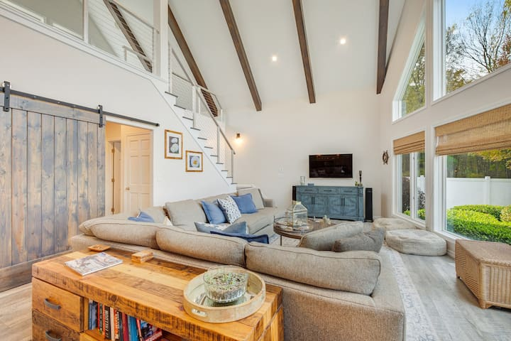 Stunning home w/ modern amenities, unparalleled tranquility, & a private beach