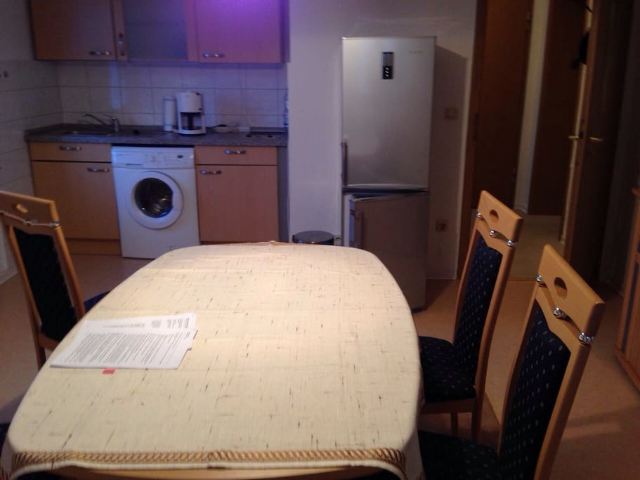 Utensils, Spices, Washing machine, Freezer and microwave is present.