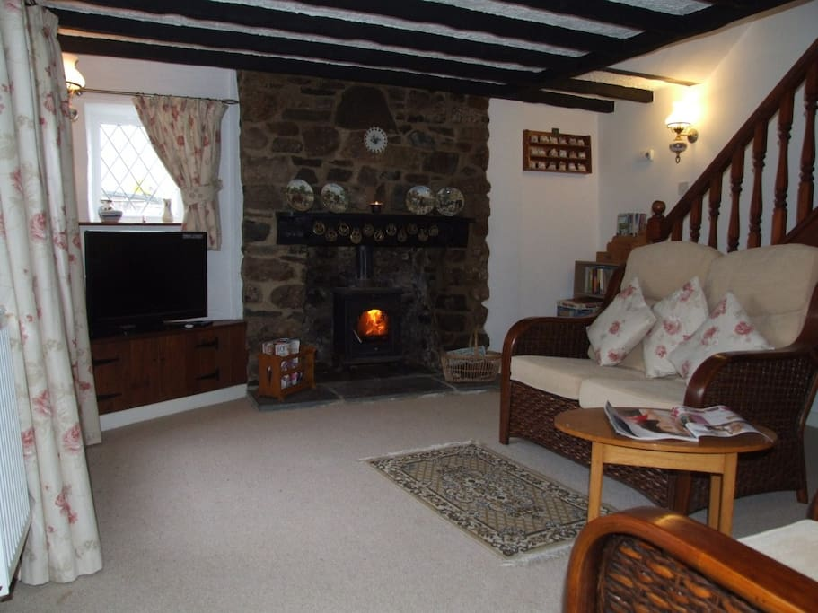 Beamed Lounge with Log Burner TV, DVD and small book and games library