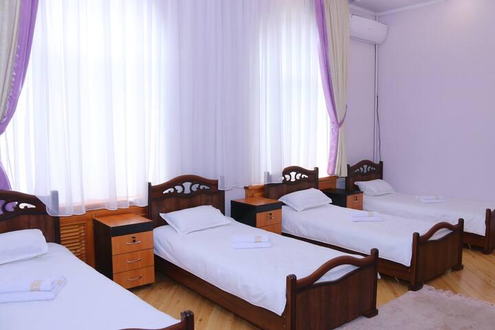 Rakat Hostel - Quadruple bedroom with bathroom