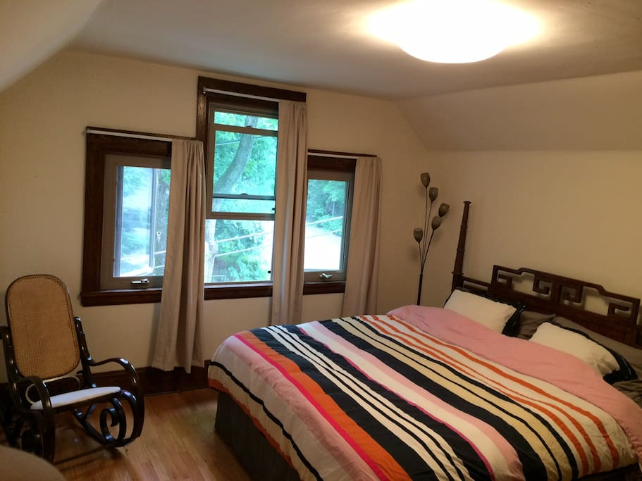 Main room with California King-Size bed, view from third floor window.