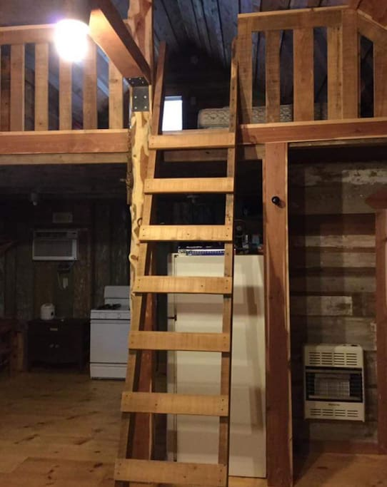 Separate loft with a double bed.