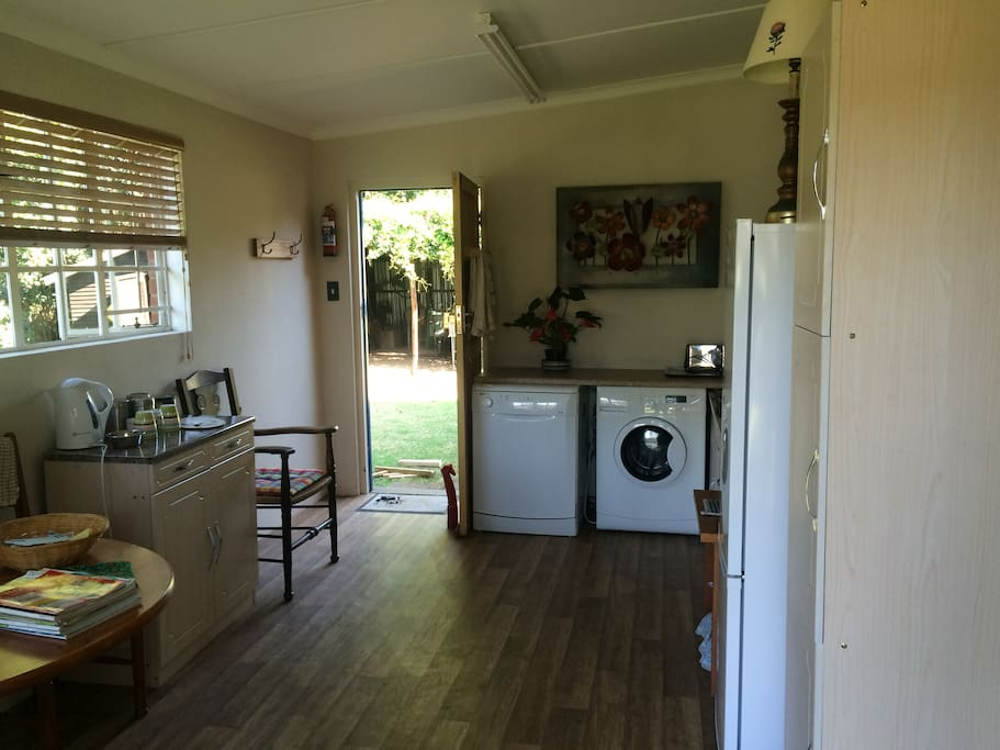 View from the front door across the dining area and kitchen to the back door