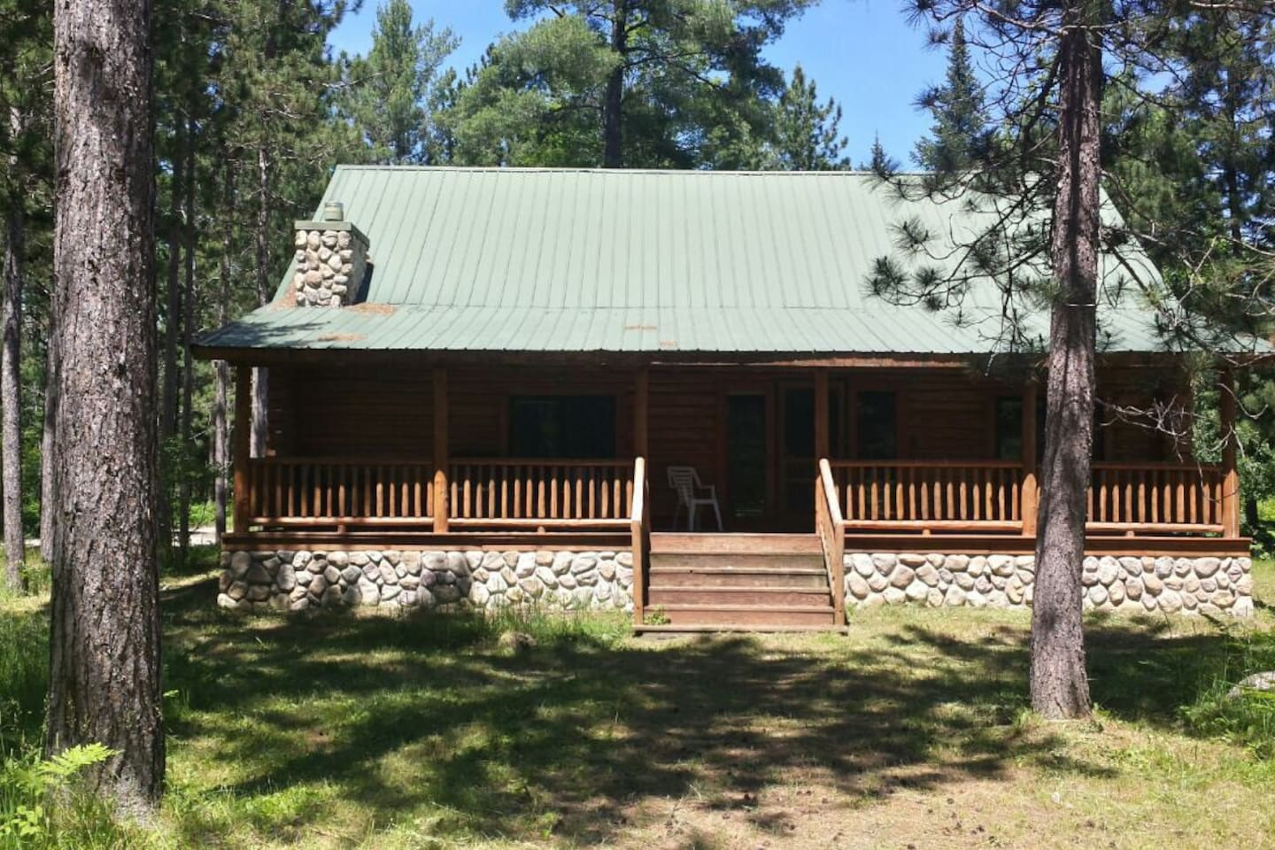 traverse log sits cabins authentic houghton on cabin pin lake city northern in michigan