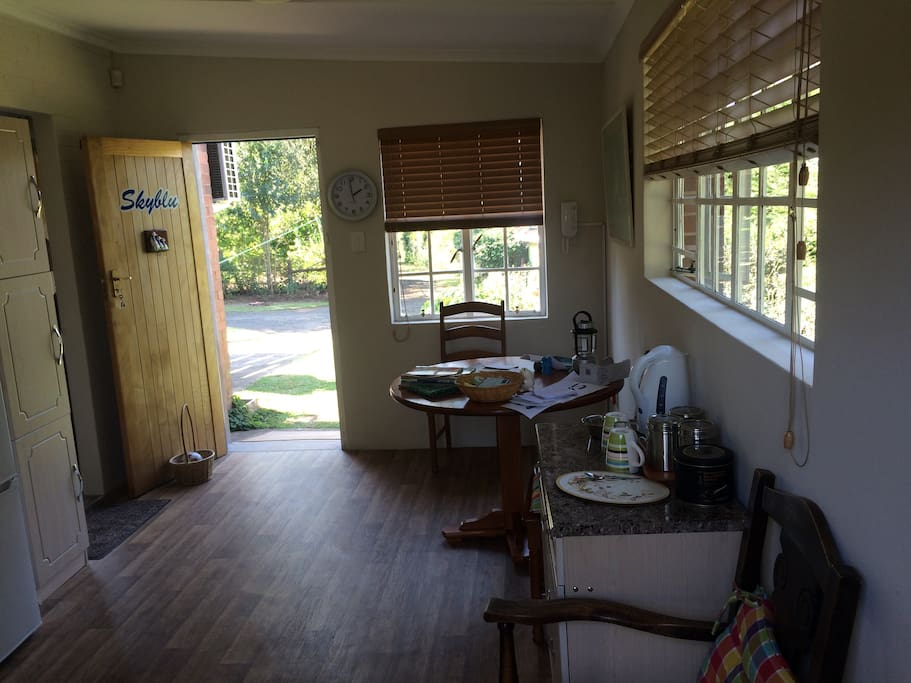 Looking from the back door and kitchen area to the dining area and front door