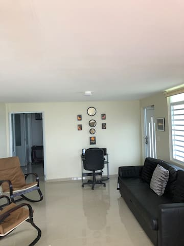 Living room and computer desk area with sofa bed