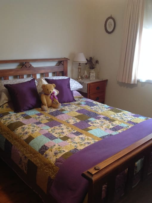 Bright room with a comfortable double bed and plenty of closet space