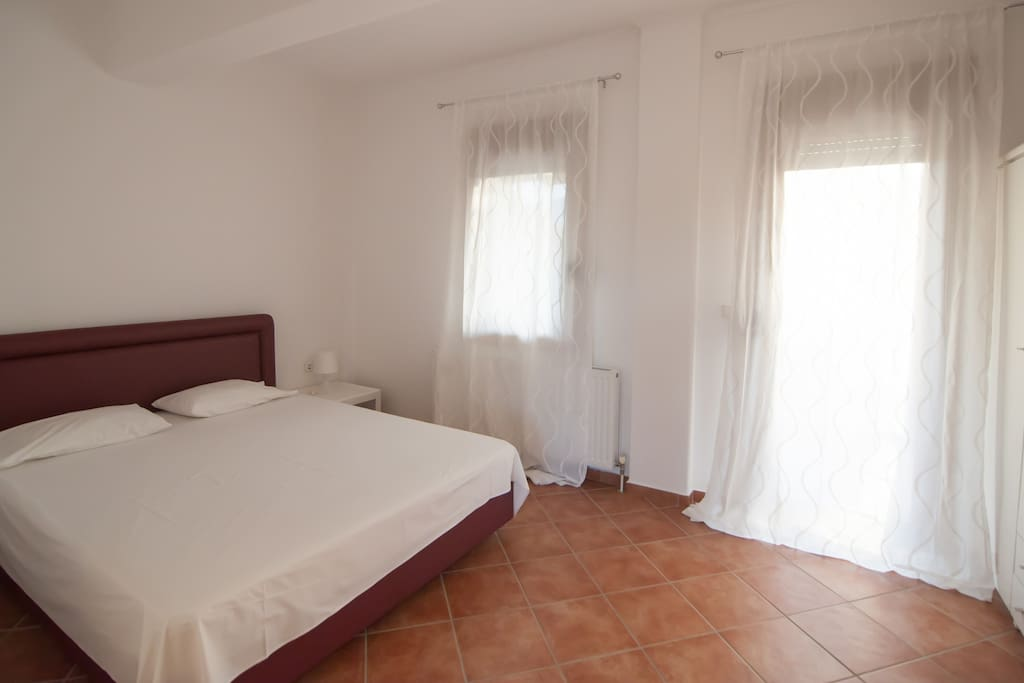 the double bedroom,with access at the balcony and an olympus view