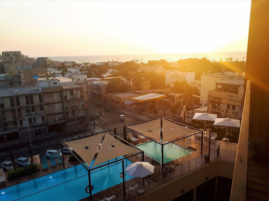 View from the apartment's balcony overlooking the ocean, two pools and the ancient port of Jaffa