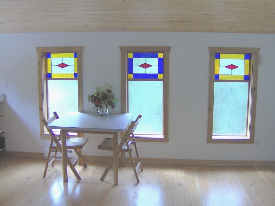 The dining area is accented by the handmade stained glass windows.