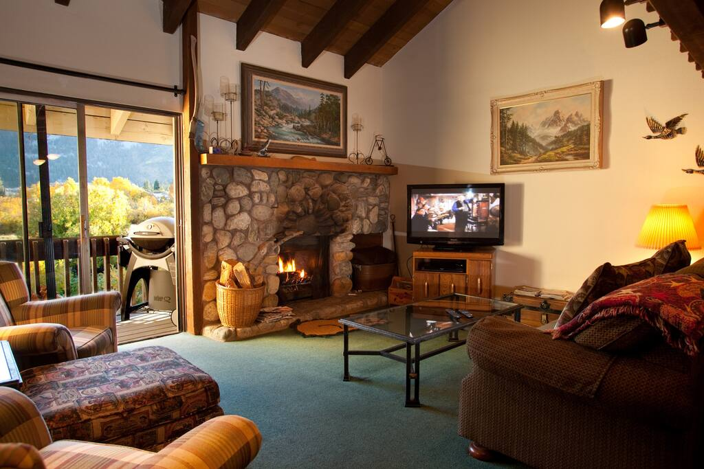 Cozy up to the fireplace while you watch some TV or look out on to the meadow.